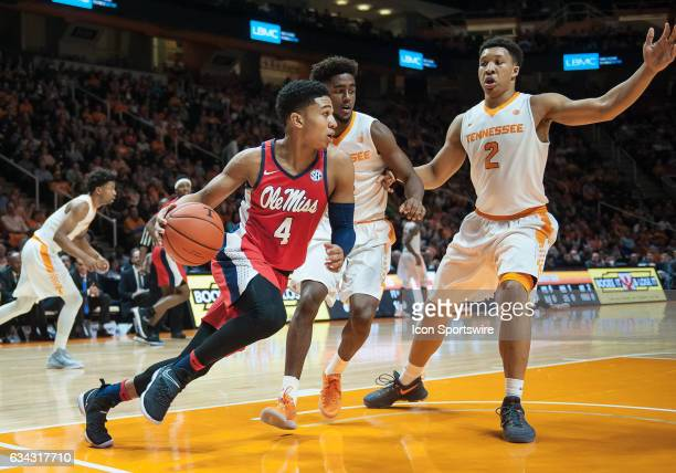 Ole Miss Rebels guard Breein Tyree drives the ball underneath Tennessee Volunteers forward Grant Williams and guard Jordan Bone during a game between...