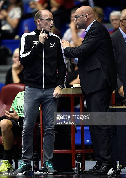 Ole Norgaard head coach of Skjern Handbold speaks to referee Henrik la Cour during the Danish Men's Handball Liga match between Aalborg Handbold and...