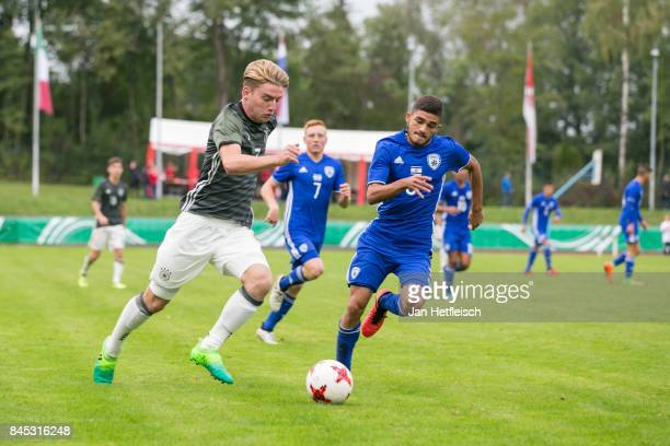 Ole Pohlmann of Germany and Ben Cohen Shmuel of Israel fight for the ball during the 'Four Nations Tournament' match between U17 Germany and U17...