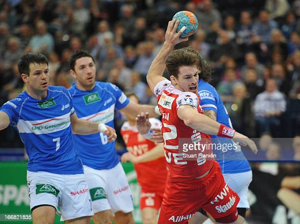 Ole Rahmel of Essen throws a goal during the DKB Bundesliga handball game between HSV Hamburg and TUSEM Essen at O2 World on April 17 2013 in Hamburg...
