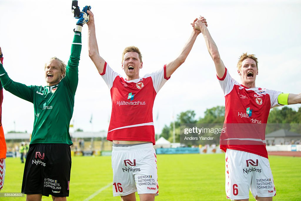 Ole Soderberg goalkeeper of Kalmar FF, David Elm of Kalmar FF and <a gi-track='captionPersonalityLinkClicked' href=/galleries/search?phrase=Rasmus+Elm&family=editorial&specificpeople=5491739 ng-click='$event.stopPropagation()'>Rasmus Elm</a> of Kalmar FF cheers to the fans after the Allsvenskan match between Falkenbergs FF andKalmar FF at Falkenbergs IP on May 29, 2016 in Falkenberg, Sweden.