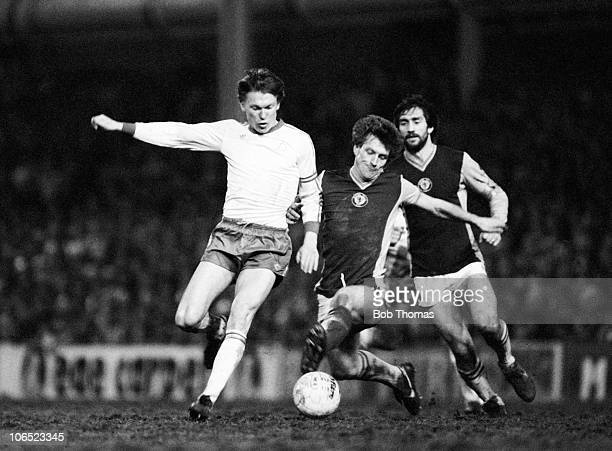 Oleg Blokhin of Dynamo Kiev is tackled by Kenny Swain of Aston Villa during their European Cup 3rd round 2nd leg match held at Villa Park Birmingham...