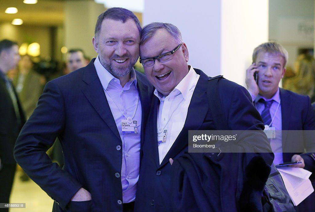Oleg Deripaska billionaire and chief executive officer of United Co Rusal left and Andrey Kostin chief executive officer of VTB Bank OJSC react as...