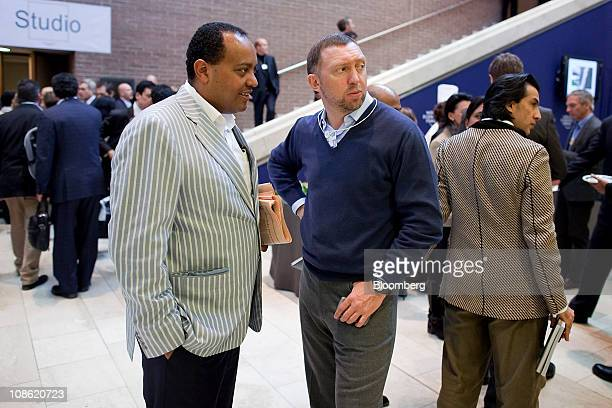 Oleg Deripaska chief executive officer of Basic Element center right speaks to an attendee between sessions on the fourth day of the World Economic...