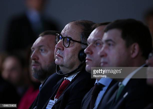 Oleg Deripaska chief executive officer of United Co Rusal left and Russian billionaire Alisher Usmanov second left listen during the opening session...