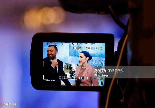 Oleg Deripaska chief executive officer of United Co Rusal left is seen through the viewfinder of a camera during a television interview on the...
