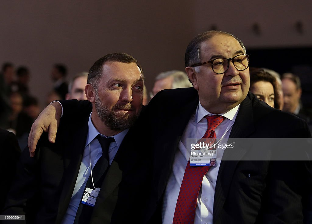 Oleg Deripaska, chief executive officer of United Co. Rusal, left, sits with Russian billionaire Alisher Usmanov, before the opening keynote speech on the first day of the World Economic Forum (WEF) in Davos, Switzerland, on Wednesday, Jan. 23, 2013. World leaders, Influential executives, bankers and policy makers attend the 43rd annual meeting of the World Economic Forum in Davos, the five day event runs from Jan. 23-27. Photographer: Chris Ratcliffe/Bloomberg via Getty Images