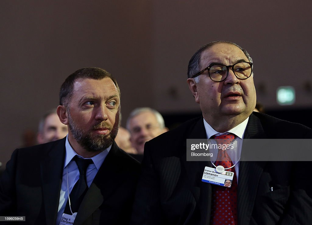 Oleg Deripaska chief executive officer of United Co Rusal left sits with Russian billionaire Alisher Usmanov before the opening keynote speech on the...
