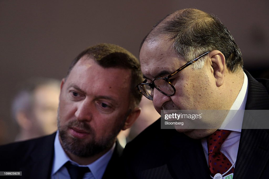 Oleg Deripaska, chief executive officer of United Co. Rusal, left, speaks with Russian billionaire Alisher Usmanov, before the opening keynote speech on the first day of the World Economic Forum (WEF) in Davos, Switzerland, on Wednesday, Jan. 23, 2013. World leaders, Influential executives, bankers and policy makers attend the 43rd annual meeting of the World Economic Forum in Davos, the five day event runs from Jan. 23-27. Photographer: Chris Ratcliffe/Bloomberg via Getty Images