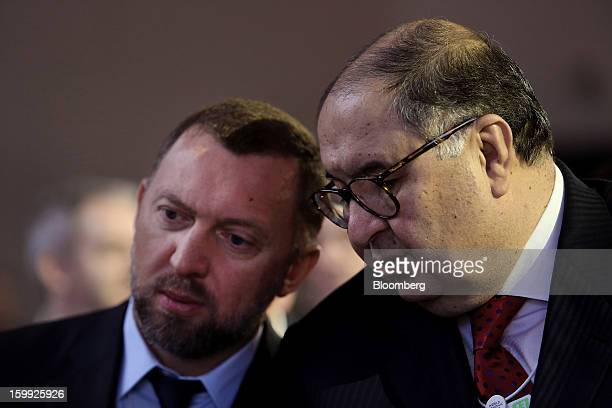 Oleg Deripaska chief executive officer of United Co Rusal left speaks with Russian billionaire Alisher Usmanov before the opening keynote speech on...