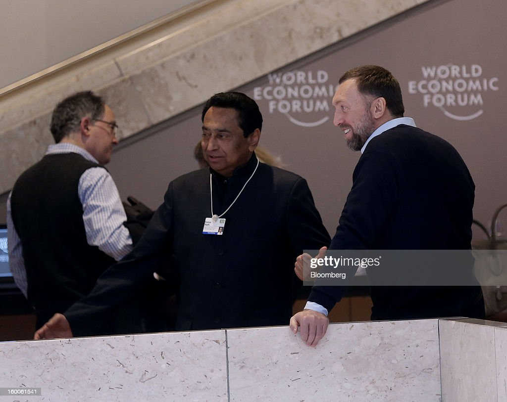 Oleg Deripaska, chief executive officer of United Co. Rusal, right, speaks Kamal Nath, India's urban development minister, center, inside the Congress Center on day three of the World Economic Forum (WEF) in Davos, Switzerland, on Friday, Jan. 25, 2013. World leaders, influential executives, bankers and policy makers attend the 43rd annual meeting of the World Economic Forum in Davos, the five day event runs from Jan. 23-27. Photographer: Simon Dawson/Bloomberg via Getty Images