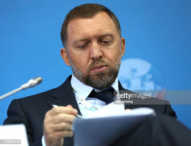 Oleg Deripaska Russian billionaire and chief executive officer of United Co Rusal checks his notes during a conference session on the opening day of...