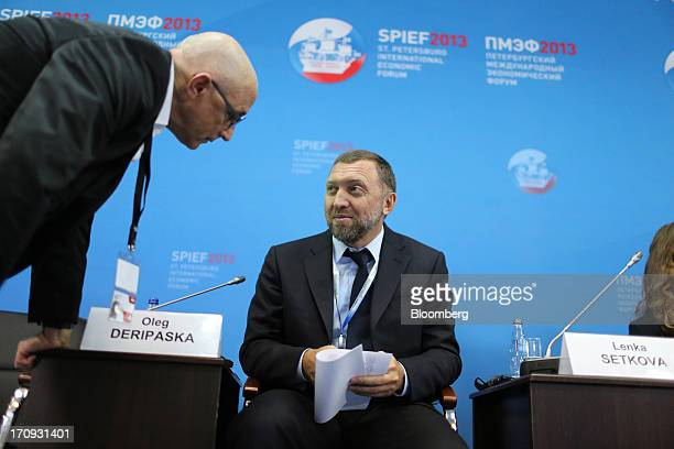 Oleg Deripaska Russian billionaire and chief executive officer of United Co Rusal center speaks to a delegate during a conference session on the...