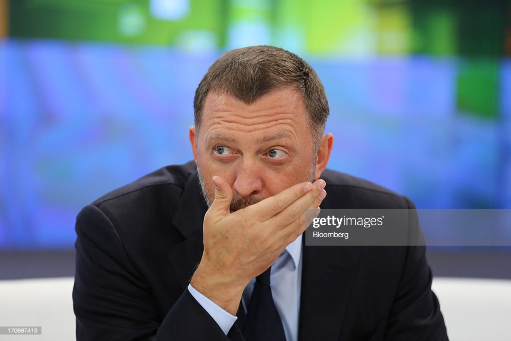 <a gi-track='captionPersonalityLinkClicked' href=/galleries/search?phrase=Oleg+Deripaska&family=editorial&specificpeople=5574016 ng-click='$event.stopPropagation()'>Oleg Deripaska</a>, Russian billionaire and chief executive officer of United Co. Rusal, gestures on the opening day of the St. Petersburg International Economic Forum 2013 (SPIEF) in St. Petersburg, Russia, on Thursday, June 20, 2013. Russian consumer spending probably eased and investment shrank at the fastest pace since 2011, adding to evidence the $2 trillion economy is stalling. Photographer: Andrey Rudakov/Bloomberg via Getty Images