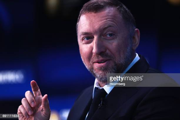 Oleg Deripaska Russian billionaire and president of United Co Rusal gestures as he speaks on the Bloomberg Television debate panel during the St...