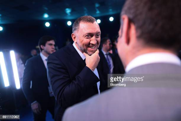 Oleg Deripaska Russian billionaire and president of United Co Rusal center reacts while speaking to Erik Schatzker television anchor at Bloomberg...