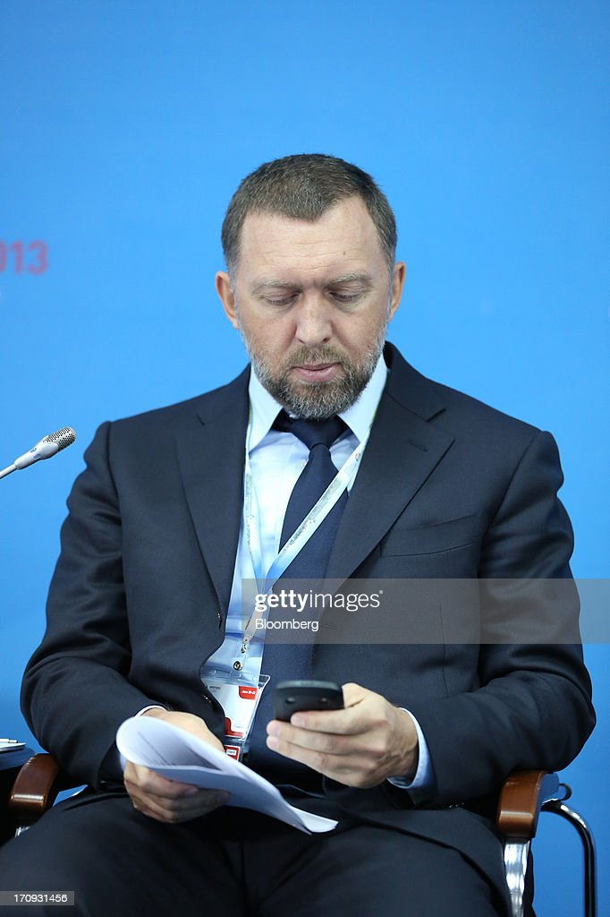 Oleg Deripaska, Russian billionaire chief executive officer of United Co. Rusal, checks his smartphone during a conference session on the opening day of the St. Petersburg International Economic Forum 2013 (SPIEF) in St. Petersburg, Russia, on Thursday, June 20, 2013. Russian consumer spending probably eased and investment shrank at the fastest pace since 2011, adding to evidence the $2 trillion economy is stalling. Photographer: Andrey Rudakov/Bloomberg via Getty Images