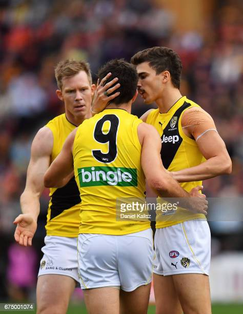 Oleg Markov of the Tigers congratulates Trent Cotchin of the Tigers during the round six AFL match between the Adelaide Crows and the Richmond Tigers...
