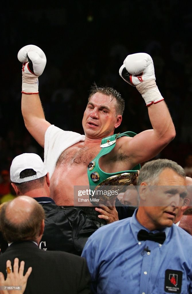 Oleg Maskaev celebrates his 12th round TKO of Hasim Rahman as referee Jay Nady walks out of the ring following their WBC World Heavyweight...