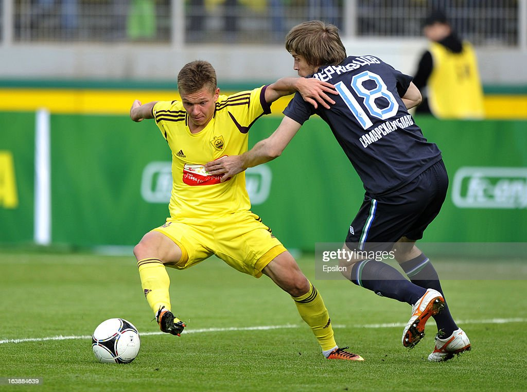 Oleg Shatov of FC Anzhi Makhachkala is challenged by Dmitry Verkhovtsov of FC Krylia Sovetov Samara during the Russian Premier League match between FC Anzhi Makhachkala and FC Krylia Sovetov Samara at the Anzhi Arena Stadium on March 17, 2013 in Kaspiysk, Russia.