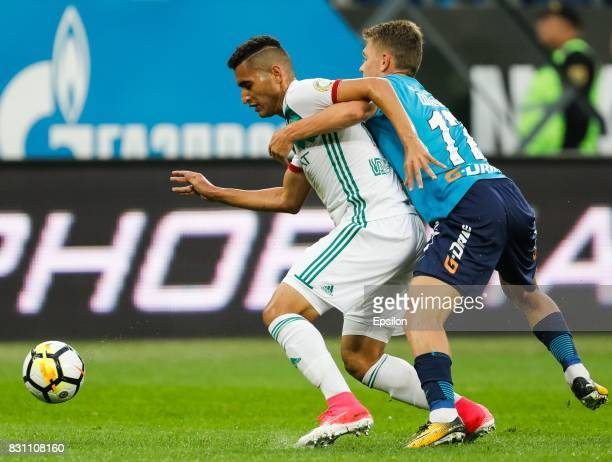 Oleg Shatov of FC Zenit Saint Petersburg and Ravanelli of FC Akhmat Grozny vie for the ball during the Russian Football League match between FC Zenit...