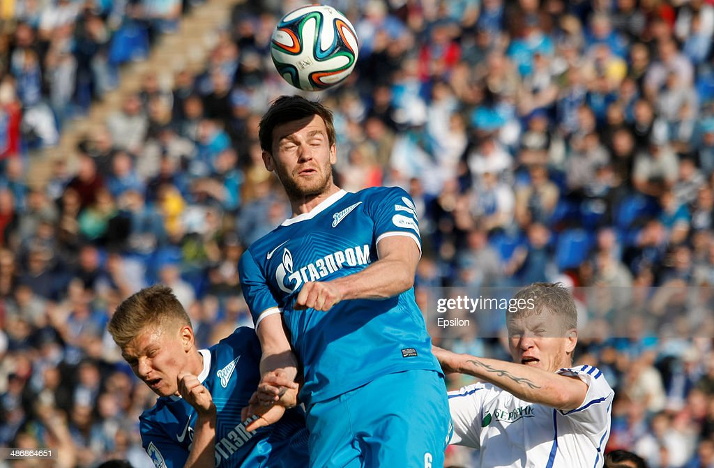<a gi-track='captionPersonalityLinkClicked' href=/galleries/search?phrase=Oleg+Shatov&family=editorial&specificpeople=9633751 ng-click='$event.stopPropagation()'>Oleg Shatov</a> of FC Zenit St. Petersburg (L), <a gi-track='captionPersonalityLinkClicked' href=/galleries/search?phrase=Nicolas+Lombaerts&family=editorial&specificpeople=4332055 ng-click='$event.stopPropagation()'>Nicolas Lombaerts</a> of FC Zenit St. Petersburg (C) and <a gi-track='captionPersonalityLinkClicked' href=/galleries/search?phrase=Denis+Kolodin&family=editorial&specificpeople=660859 ng-click='$event.stopPropagation()'>Denis Kolodin</a> of FC Volga Nizhny Novgorod vie for a header during the Russian Football League Championship match between FC Zenit St. Petersburg and FC Volga Nizhny Novgorod at the Petrovsky stadium on April 26, 2014 in St. Petersburg, Russia.