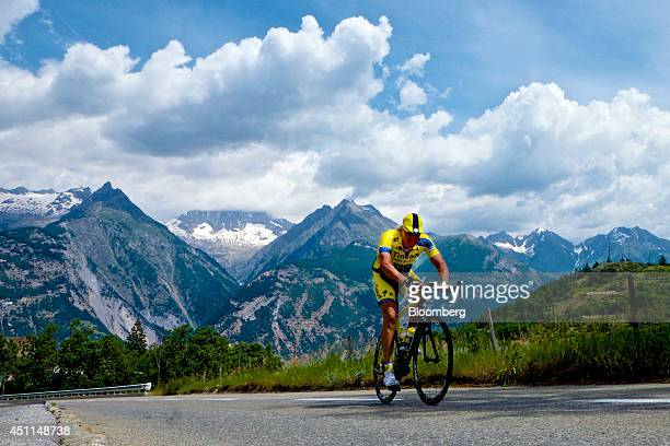 Oleg Tinkov a Russian millionaire and founder of TCS Group Holding Plc rides his road bike through the mountains dressed in the colors of his pro...