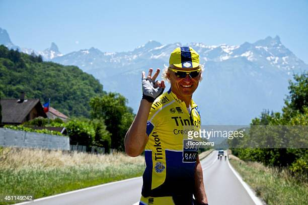 Oleg Tinkov a Russian millionaire and founder of TCS Group Holding Plc gestures before he rides his road bike through the mountains dressed in the...