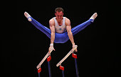 Oleg Verniaiev of Ukraine competes on the Parallel Bars during day ten of The World Artistic Gymnastics Championships at The SSE Hydro on November 01...