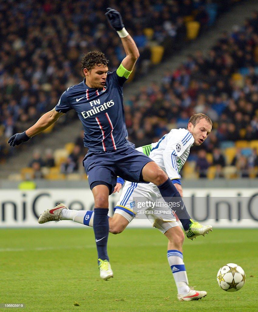 Oleh Gusev (R) of FC Dynamo Kiev fights for a ball with Thiago Silva of Paris Saint-Germain FC during their UEFA Champions League Group A football match in Kiev on November 21, 2012.