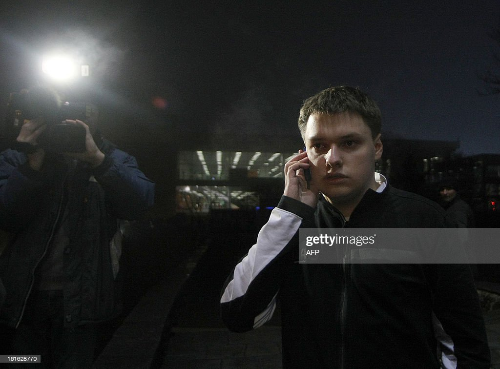 Oleh Osheka, one of the passenger of Antonov AN-24 plane which made an emergency landing in the eastern Ukraine city of Donetsk, on February 13, 2013 . 'Most passengers have been rescued. Right now, we have four dead,' local governor Andrey Shyshatsky told reporters at the airport. The plane was flying from the resort city of Odessa in the south when it overturned and began breaking up upon landing at Donetsk airport. AFP PHOTO/ALEXANDER KHUDOTEPLY