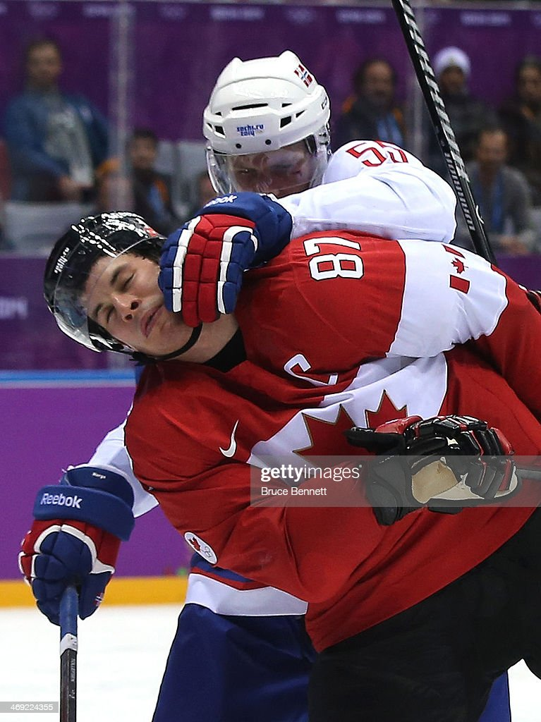 Olekristian Tollefsen #55 of Norway pushes <a gi-track='captionPersonalityLinkClicked' href=/galleries/search?phrase=Sidney+Crosby&family=editorial&specificpeople=212781 ng-click='$event.stopPropagation()'>Sidney Crosby</a> #87 of Canada during the Men's Ice Hockey Preliminary Round Group B game on day six of the Sochi 2014 Winter Olympics at Bolshoy Ice Dome on February 13, 2014 in Sochi, Russia.