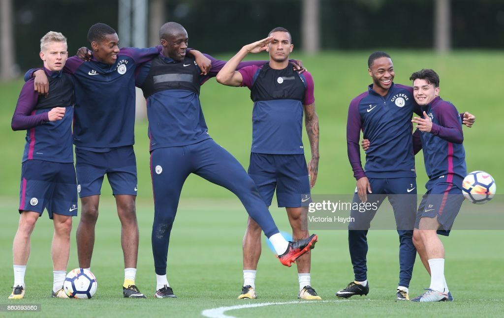 Oleksandar Zinchenko, Tosin Adarabioyo, Yaya Toure, Danilo, Brahim Diaz and Raheem Sterling pose for a photo during training at Manchester City Football Academy on October 12, 2017 in Manchester, England.