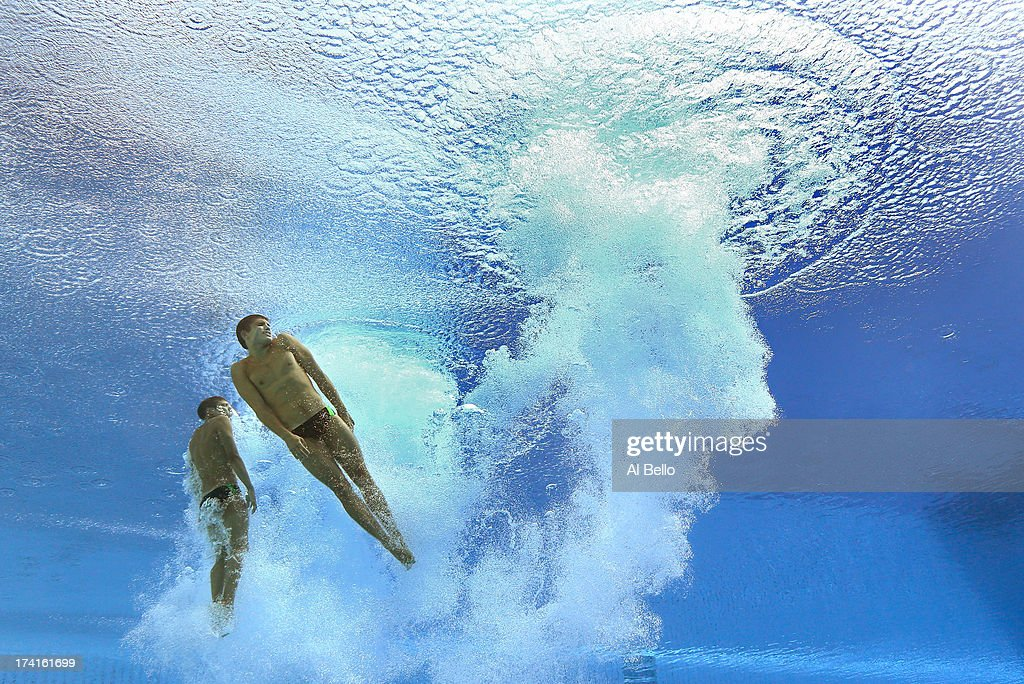 Oleksandr Gorshkovozov and Dmytro Mezhenskyi of Ukaine compete in the Men's 10m Platform Synchronised Diving final on day two of the 15th FINA World Championships at Piscina Municipal de Montjuic on July 21, 2013 in Barcelona, Spain.