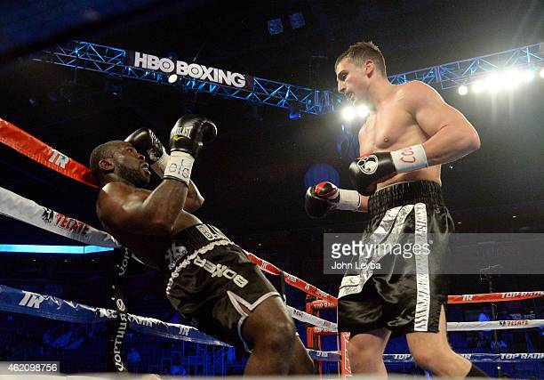 Oleksandr Gvozdyk lands a punch to the face of Cory Cummings during the second round of their Super Welterweight fight January 24 2015 at 1st Bank...