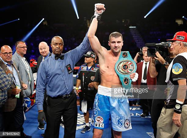 Oleksandr Gvozdyk of Ukraine poses with referee Kenny Bayless after Gvozdyk defeated Tommy Karpency in a light heavyweight fight at MGM Grand Garden...