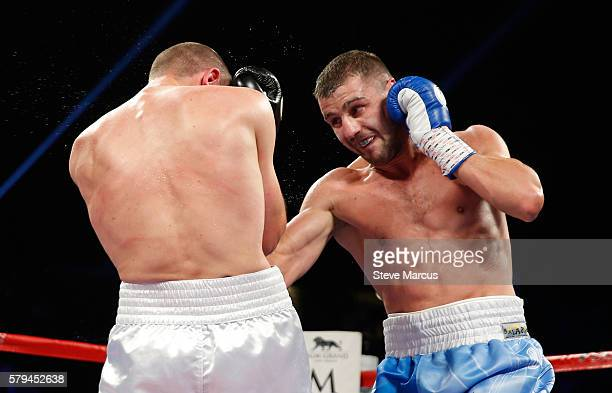 Oleksandr Gvozdyk of Ukraine punches Tommy Karpency during their light heavyweight bout at MGM Grand Garden Arena on July 23 2016 in Las Vegas Nevada...