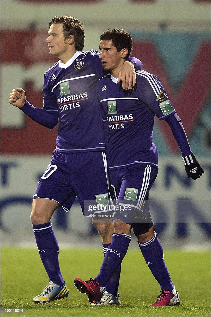 Oleksandr Iakovenko of RSC Anderlecht celebrates scoring a goal with Guillaume Gillet of RSC Anderlecht during the Jupiler League match between Sporting Lokeren and Sporting Anderlecht on January 26, 2013 in Lokeren, Belgium.