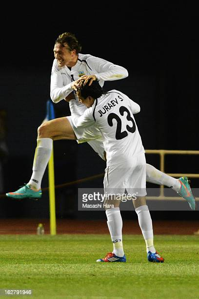 Oleksandr Pyschur of Bunyodkor celebrates the first goal during the AFC Champions League Group G match between Sanfrecce Hiroshima and Bunyodkor at...