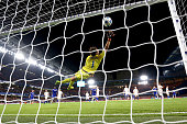 Oleksandr Shovkovskiy of Dynamo Kyiv fails to stop a shot from Willian of Chelsea for his side's second during the UEFA Champions League Group G...