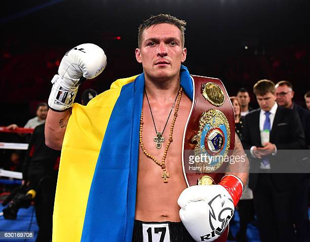 Oleksandr Usyk of the Ukraine poses with his belt after beating Thabiso Mchunu of South Africa to win the WBO Cruiserweight title at The Forum on...