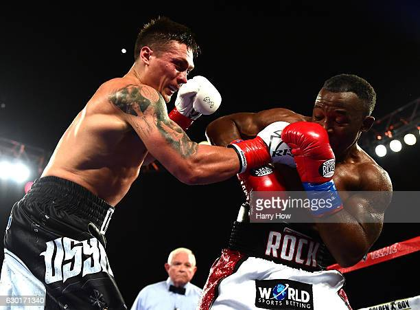 Oleksandr Usyk of the Ukraine punches Thabiso Mchunu of South Africa to win the WBO Cruiserweight title at The Forum on December 17 2016 in Inglewood...