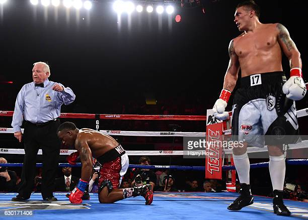 Oleksandr Usyk of the Ukraine waits as Thabiso Mchunu of South Africa receives a count from the referee as Usyk goes on to win the WBO Cruiserweight...