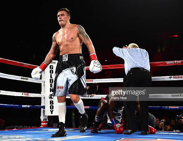 Oleksandr Usyk of the Ukraine walks to a corner after a knock down of Thabiso Mchunu of South Africa to win the WBO Cruiserweight title at The Forum...