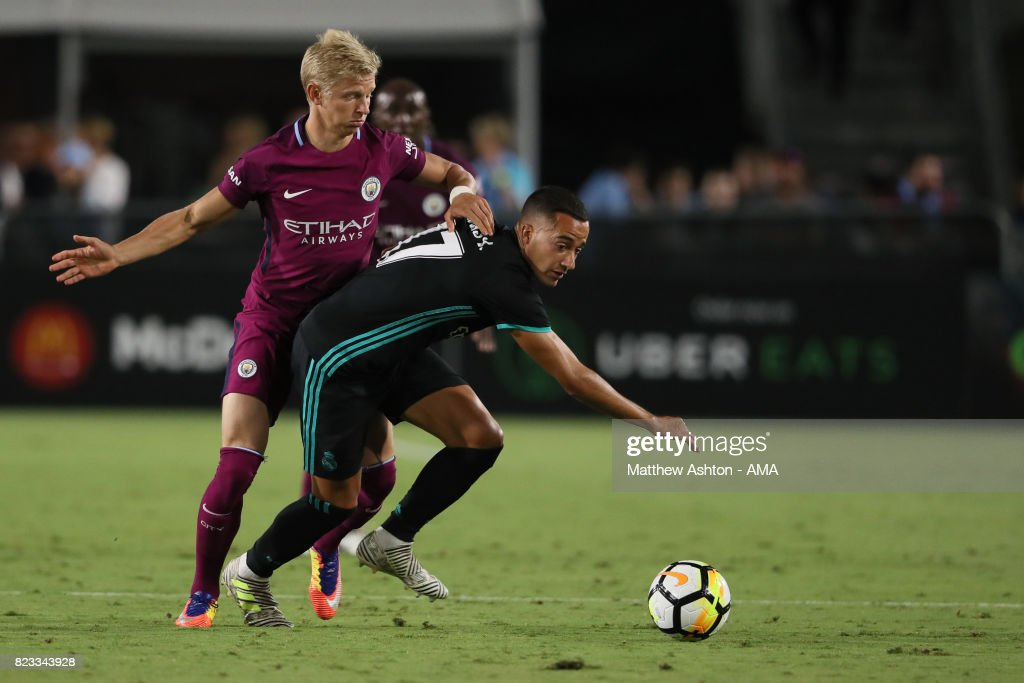 http://media.gettyimages.com/photos/oleksandr-zinchenko-of-manchester-city-and-lucas-vazquez-of-real-picture-id823343928