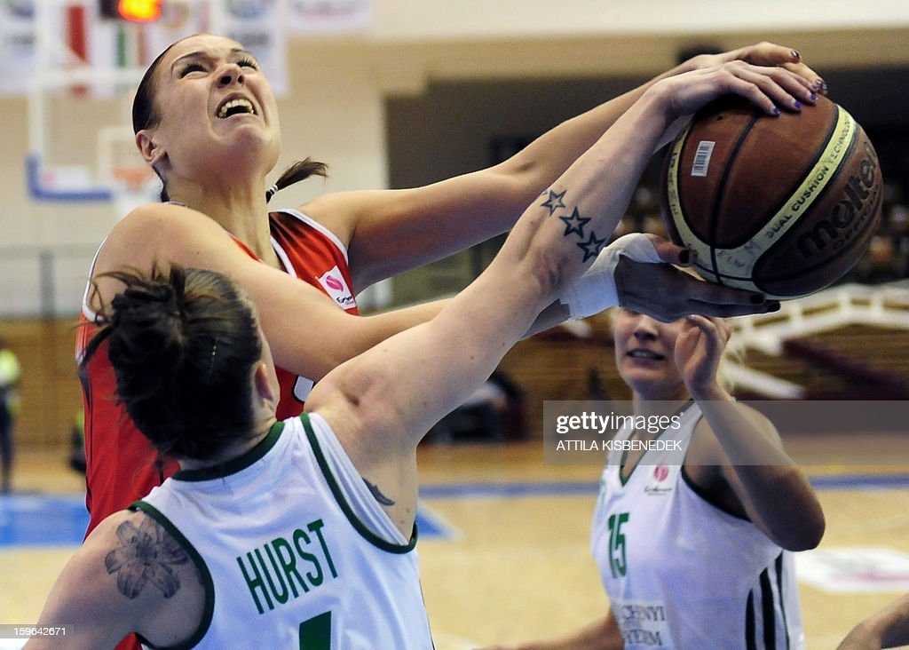Oleksandra Kurasova (up) of Spanish Rivas Ecopolis vies for the ball with captain Nora Nagy-Bujdoso (R) and Anne Hurst (front) of Hungarian Hat-Agro UNI Gyoer during the Women Euroleague basketball match Hungarian Hat-Agro UNI Gyoer vs Spanish Rivas Ecopolis on January 17, 2013 in Gyoer, Hungary.