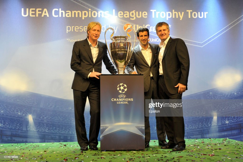 Oleksey Mykhailychenko, UniCredit Bank Ambassador for the UEFA Champions League Tropy Tour 2011 in Ukraine (L) with <a gi-track='captionPersonalityLinkClicked' href=/galleries/search?phrase=Luis+Figo&family=editorial&specificpeople=201507 ng-click='$event.stopPropagation()'>Luis Figo</a> and <a gi-track='captionPersonalityLinkClicked' href=/galleries/search?phrase=Davor+Suker&family=editorial&specificpeople=235899 ng-click='$event.stopPropagation()'>Davor Suker</a> during a press conference at the UEFA Champions League Trophy Tour 2011 on September 30, 2011 in Kiev, Ukraine.
