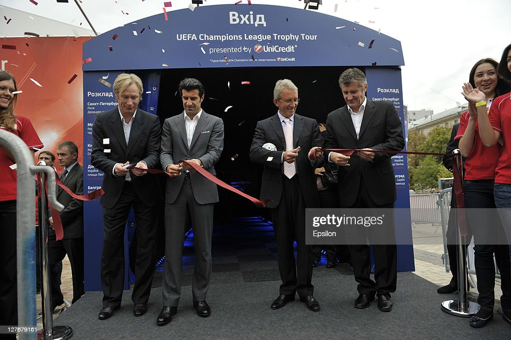 Oleksey Mykhailychenko, UniCredit Bank Ambassador for the UEFA Champions League Tropy Tour 2011 in Ukraine, Luis Figo, Borys Tymonkin and Davor Suker cut tape during opening ceremony of the UEFA Champions League Trophy Tour 2011 on September 30, 2011 in Kiev, Ukraine.