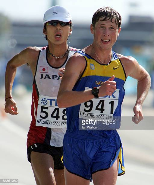 Oleksiy Kazanin of Ukraine and Yuki Yamazaki of Japan compete during the men's 50 Kilometres Race Walk final at the 10th IAAF World Athletics...