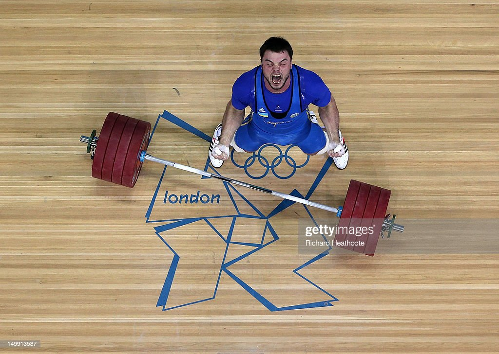 Oleksiy Torokhtiy of Ukraine celebrates after winning the gold medal in the Men's 105kg Weightlifting on Day 10 of the London 2012 Olympic Games at ExCeL on August 6, 2012 in London, England.